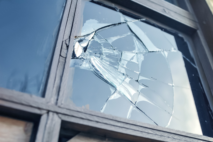 broken window with shattered glass