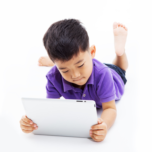 boy reading from a laptop