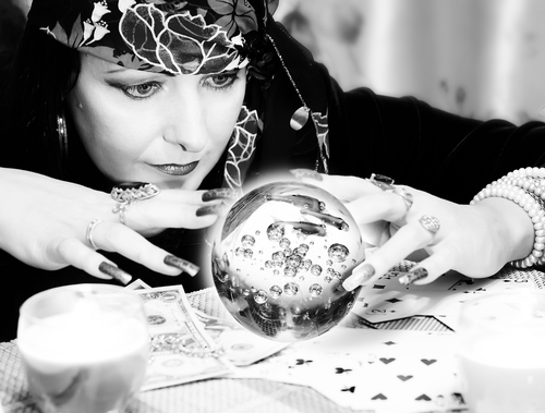 Black and white portrait of fortune-teller with chrystal ball - stock photo
