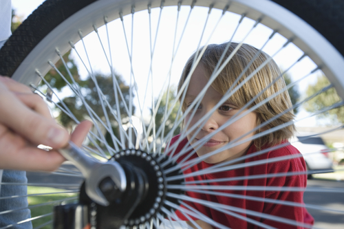 Doing up nut on bike wheel
