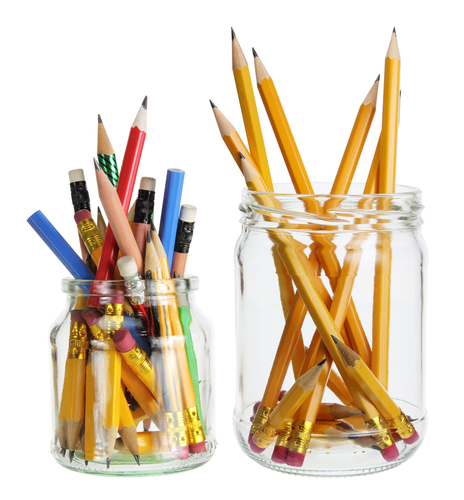Two glass jars filled with pencils