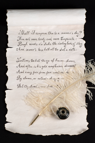 Shakespeare's Sonnet 18 on old paper scroll. - stock photo