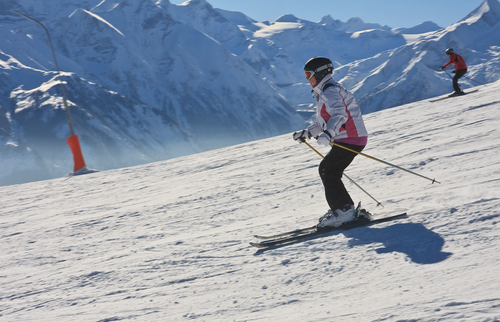 Image of a skier going down a slope