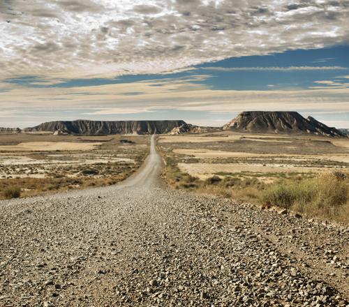 Wild west road landscape. - stock photo