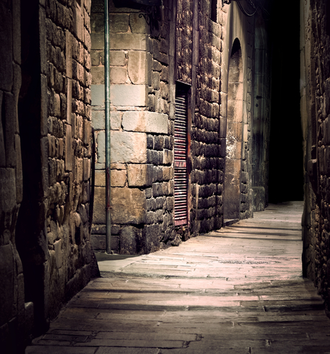 Dark alleyway with stone walls