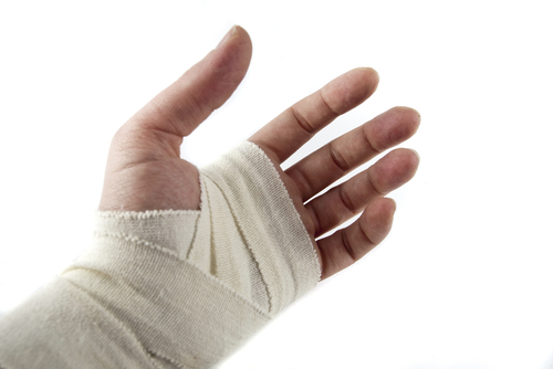 a hand with a bandage on it