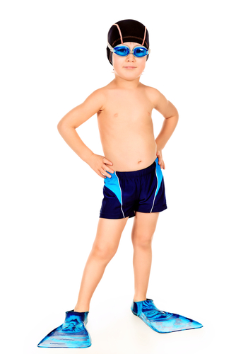 boy in flippers and swimming trunks
