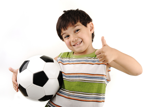 Young boy holding a football