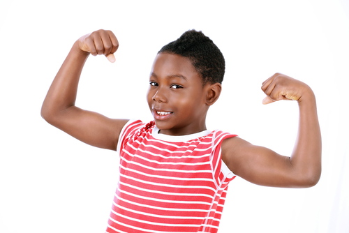 Child showing arm muscles