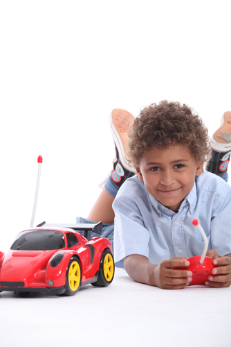 Child with radio-controlled car