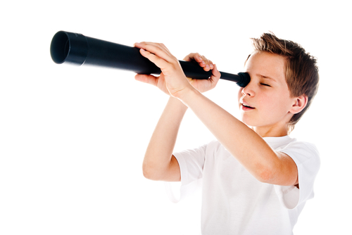 boy using telescope