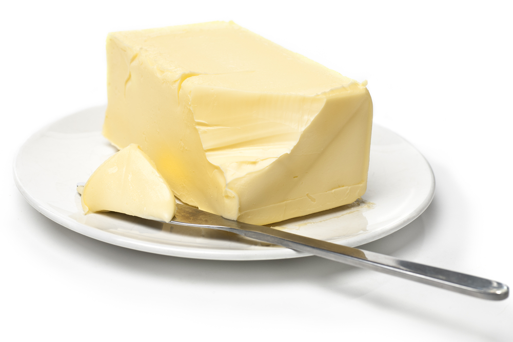 Butter and knife on a plate
