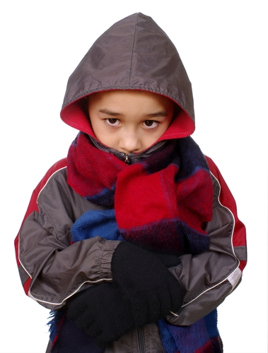 Child in warm coat and scarf
