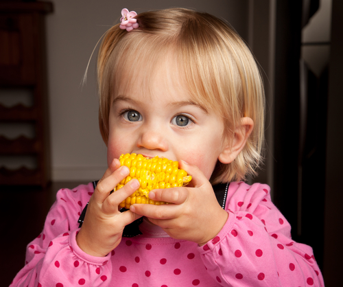 girl eating sweetcorn