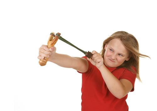 Girl using catapult