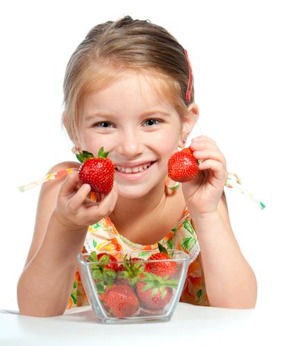 Girl holding strawberries