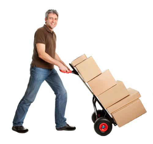 Man pushing barrow of boxes