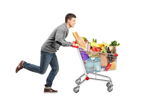 Man pushing supermarket trolley