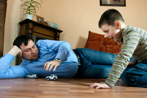 Boy and dad playing with toy car