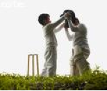 Boys playing cricket