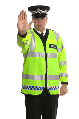 a policeman saying stop