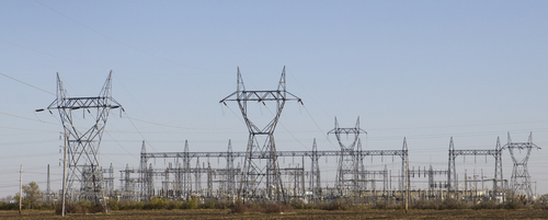 Large high voltage pylons carry the cables from a power station.