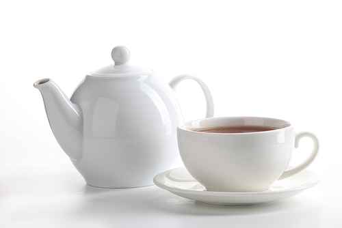 a teapot and teacup full of tea