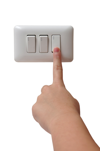 Finger pressing a switch